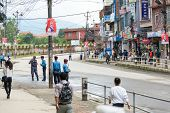 KATHMANDU, NEPAL - AUGUST 3, 2014: Boudhanath Sadak is empty before Indian Prime Minister Narendra Modi arrives in Kathmandu on a 2-day official Nepal visit.