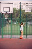 Beautiful Young Woman With Basketball Outdoors