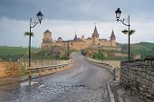Road leading to the medieval castle. Fortification historical landmark. Cityscape at morning. Kamene