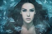 stock photo of surreal  - surreal mermaid woman portrait surrounded by fishes - JPG