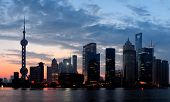 Shanghai morning silhouette before sunrise with city skyline and colorful sky over Huangpu River