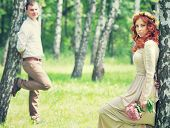 Romantic gentle bride and handsome groom posing near birch trees, beautiful young loving couple, sum