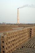SARBERIA,INDIA, JANUARY 14: A Brickfield is a large landed area, used for manufacturing bricks. Tool