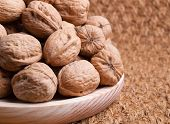 Walnuts On A Wooden Plate