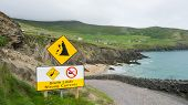 Clare cliffs of Moher with danger sign and road