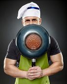 Man Chef Hiding His Face Behind A Wok Pan