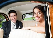 Bride And Groom Inside A Beautiful Classic Car