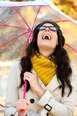 image of rainy season  - Happy woman having fun in autumn - JPG