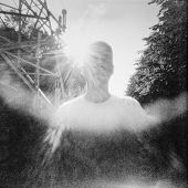 Sunny summertime portrait in lomography style.  Used pinhole film camera. Image contains grain and blur.