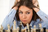 pic of chessboard  - Young beautiful businesswoman devises Business strategy - JPG