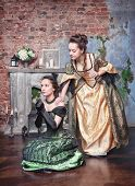 Beautiful Woman In Medieval Dress Consoling Her Friend