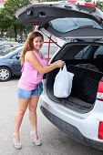 Lady Loading Her Car Trunk With Bag After Mall Shopping