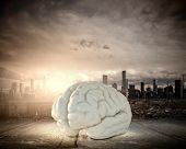 Huge human brain against modern city background