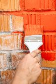 Orange Brick Wall Painted With Red Color
