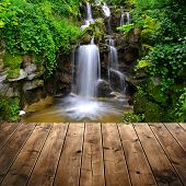 Beautiful waterfall with wooden planks