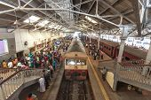HIKKADUWA, SRI LANKA - FEBRUARY 22, 2014: Crowds waiting on Colombo platform. Colombo is the main hu