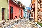 Medieval Street View In Sighisoara Founded By Saxon Colonists In Xiii Century, Romania