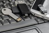 Usb  And Micro Usb Keys With  Smartphone On The Laptop Keyboard