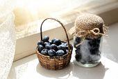 Fresh blueberries on window sill