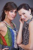 pic of friendship belt  - two happy female friends posing in a studio - JPG