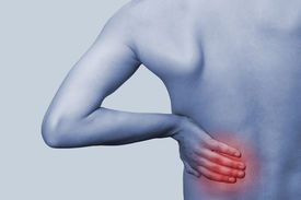 stock photo of sick kidney  - Young male holding his back in pain - JPG