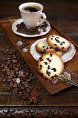 Cup Of Coffee, Coffee Beans And Chocolate Chip Cookies