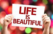 Life is Beautiful card with colorful background with defocused lights