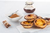 picture of pasteis  - Closeup of delicious traditional asian dessert egg tarts - JPG