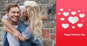 Man giving his pretty girlfriend a piggy back against happy valentines day