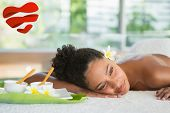 Gorgeous woman lying on massage table with salt treatment on back against heart