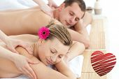 Relaxing couple having a massage against red heart