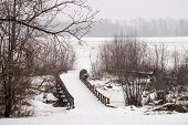 stock photo of battlefield  - A wooden bridge during the snow at Monmouth Battlefield State Park in New Jersey - JPG