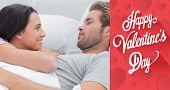 Couple awaking and looking at each other against cute valentines message