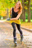 Girl Athlete Fast Rides On Roller Skates