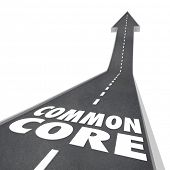 Common Core words on a road leading upward to success to illustrate new school standards in learning and testing and revised curriculum