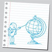 Schoolkid pointing on desk globe