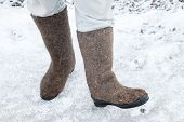 Male Feet With Russian Felt Boots On Winter Road