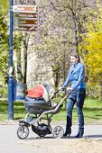 woman with a pram on spring walk
