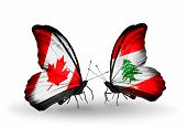 Two Butterflies With Flags On Wings As Symbol Of Relations Canada And Lebanon