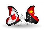 picture of papua new guinea  - Two butterflies with flags on wings as symbol of relations Canada and Papua New Guinea - JPG