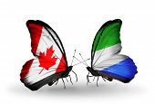 Two Butterflies With Flags On Wings As Symbol Of Relations Canada And Sierra Leone