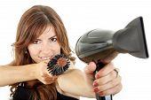 Beautifule Female Hairdresser Using Hairdryer And Hairbrush