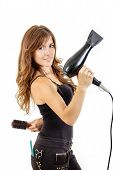Professional Caucasian Brunette Female Hairdresser Holding Hairdryer In Hand With Comb