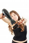Young Woman With Blow Dryer And Hairbrush Working
