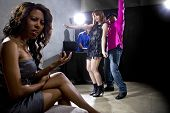 picture of cheating  - black male cheating on girlfriend with seductive white female at club - JPG