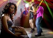 image of cheating  - black male cheating on girlfriend with seductive white female at club - JPG