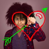 Young Teenage Girl With Afro Hair Drawing A Love Heart