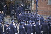 84th Precinct officers enter mortuary