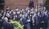 Widow of Wenjian Liu with NYPD flag