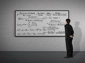 Businessman Looking To Mathematic Formulas